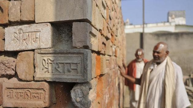 Devotees touch bricks with 'Shri Ram' embossed and engraved on them during a visit to the Ram Janm Bhoomi Nyas workshop at Karsevak Puram on the day of the Supreme Court verdict in the Ram Janmabhoomi Babri Masjid case, at Ayodhya, Uttar Pradesh.(Deepak Gupta/ HT Photo)