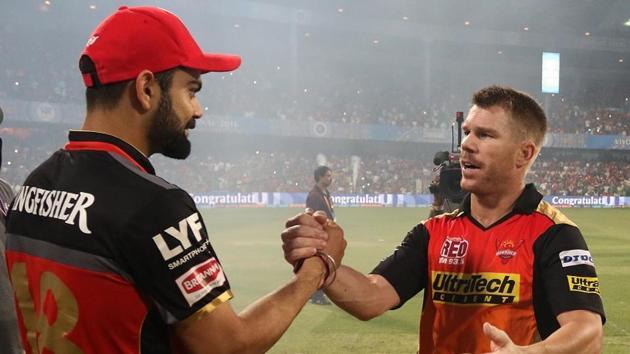 File photo of Royal Challengers Bangalore captain Virat Kohli and Sunrisers Hyderabad captain David Warner.(BCCI)