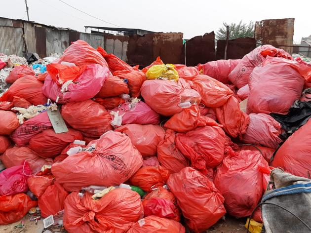 Biomedical waste recovered during a raid at Makhan Majra village in Chandigarh. The waste was found in bags with markings of Mohali-based Ivy Hospital. Other bags had barcodes registered in Haryana.(HT PHOTO)