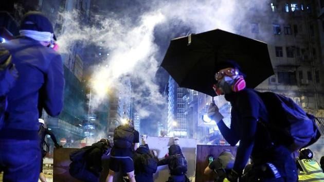 """Violence at pro-democracy protests in Hong Kong that saw a police officer shoot a masked demonstrator and a man set on fire is """"deeply disturbing"""", the British government said Monday.(Reuters image)"""