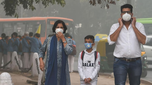 People wearing masks amid heavy smog in New Delhi last week. The air quality dipped to hazardous 'severe plus' category.(PTI Photo)