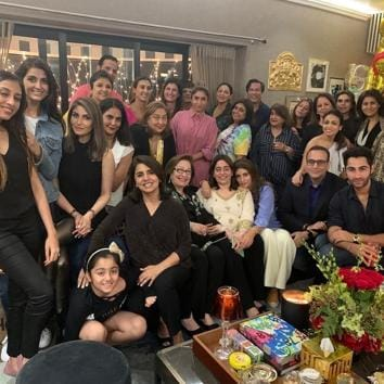 Nitasha Nanda (seated in white) with family and friends at one of her birthday celebrations in the city.