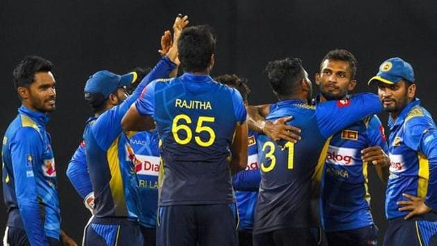 Representative image: Players of Sri Lanka cricket team celebrate after the fall of a wicket during a match.(AFP)
