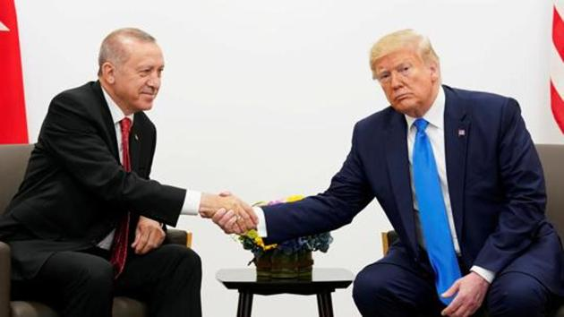 US President Donald Trump shakes hands with Turkey's President Tayyip Erdogan during a bilateral meeting.(REUTERS Photo)