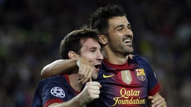 Barcelona's Lionel Messi (L) is congratulated by team mate David Villa after scoring his second goal against Spartak Moscow during their Champions League Group G soccer match at Nou Camp stadium in Barcelona (File Photo)(REUTERS)