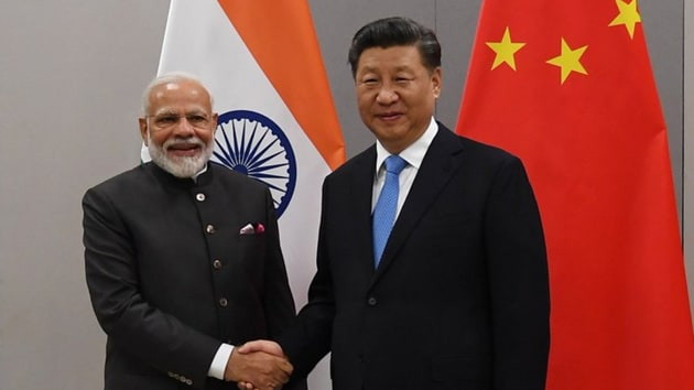 PM Modi and Chinese president Xi agreed to maintain a close contact on matters relating to trade and investment to further deepen and add new vigour to the bilateral ties.(Photo Credit: MEA / Twitter)