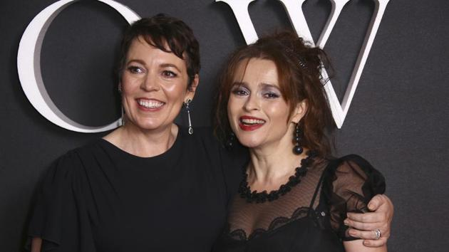 Helena Bonham Carter, right, and Olivia Colman pose for photographers at the world premiere of The Crown season 3.(Joel C Ryan/Invision/AP)