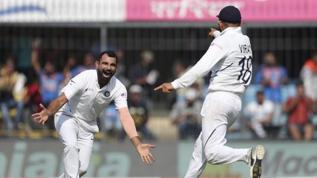 India's Mohammed Shami, left, celebrates with captain Virat Kohli the dismissal of Bangladesh's Mushfiqur Rahim during the first day of first cricket test match between India and Bangladesh in Indore, India, Thursday, Nov. 14, 2019. (AP Photo/Aijaz Rahi)(AP)