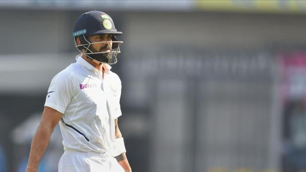 Indian captain Virat Kohli reacts as he walks back to pavilion after his dismissal on the second day of the first cricket test match against Bangladesh, in Indore.(PTI)