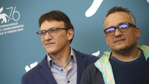 Producers Anthony Russo, left, and Joe Russo pose for photographers at the photo call for the film Mosul at the 76th edition of the Venice Film Festival in Venice.(Joel C Ryan/Invision/AP)