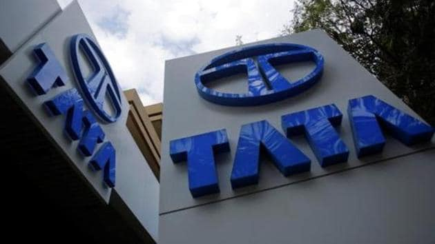 Tata Motors logos are seen at their flagship showroom in Mumbai February 14, 2013. REUTERS/Vivek Prakash/Files