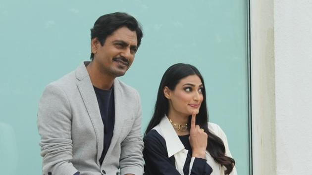 Nawazuddin Siddiqui and Athiya Shetty during a Motichoor Chaknachoor promotional event.(IANS)