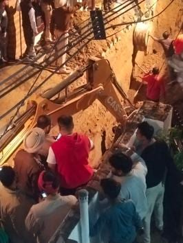 The rescue operation initiated by the administration and police in Khanna after the cave-in claimed the lives of two labourers.(HT Photo)
