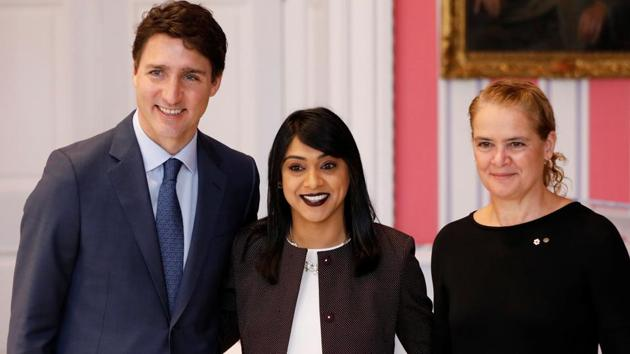 Bardish Chagger (in centre) poses with Canada's Prime Minister Justin Trudeau and Gov. Gen. Julie Payette after being sworn-in as Minister of Diversity, Inclusion and Youth during the presentation of Trudeau's new cabinet, at Rideau Hall in Ottawa, Ontario, Canada November 20, 2019.(REUTERS)