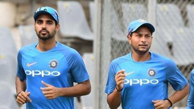 File image of Bhuvneshwar Kumar and Kuldeep Yadav (R).(AFP)