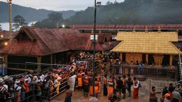 According to legend in Sabarimala the 18 steps are most sacred and each step signifies certain messages. Pilgrims who do not carry their offering bundle on their head will not be allowed to climb these steps.(REUTERS PHOTO.)