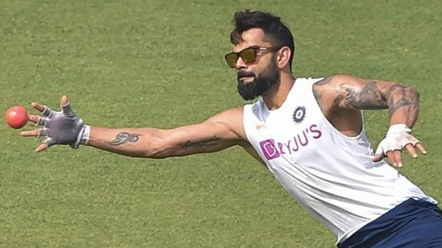 Kolkata: Indian captain Virat Kohli dives to take a catch during a training session.(PTI)