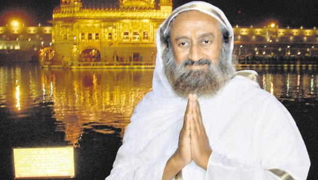 """Spiritual leader and founder of Art of Living Foundation Sri Sri Ravi Shankar after paying obeisance at the Golden Temple in Amritsar on Saturday. He will be chief guest at Guru Nanak Dev University's 50th foundation day function on Sunday. """"I will definitely go to Nankana Sahib and Kartarpur Sahib gurdwaras,"""" he said, without revealing any schedule.(Sameer Sehgal/ HT)"""