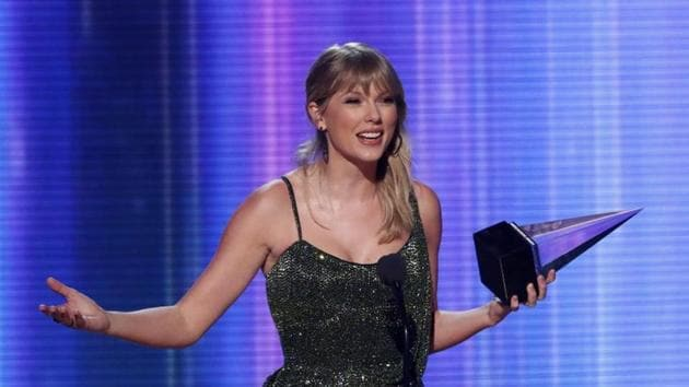 Taylor Swift accepts the Favorite Album Pop/Rock award for Lover at 2019 American Music Awards.(REUTERS)