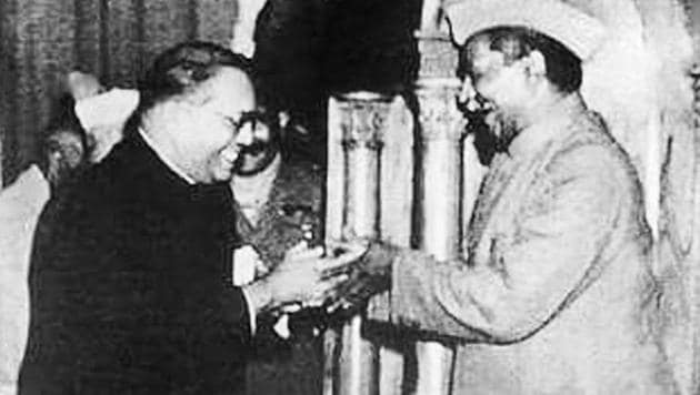 Dr BR Ambedkar, chairman of the Drafting Committee (left), presents the final draft of the Indian Constitution to Dr Rajendra Prasad.(Alamy Stock Photo)