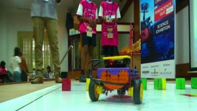 Students showing their robots at the National Roboscience contest.(ANI)