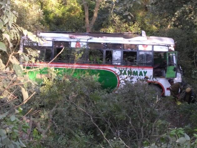 The bus after it fell into the gorge in Kangra district on Monday afternoon.(HT Photo)