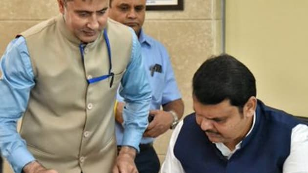 Devendra Fadnavis got busy with work in his second stint as chief minister of Maharashtra by signing his first cheque for a relief fund.(@CMOMaharashtra)