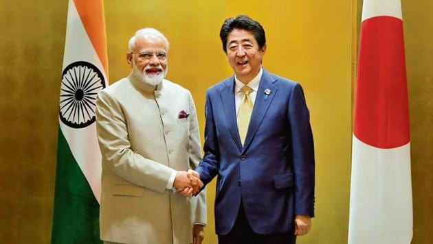 PM Narendra Modi with Japan PM Shinzo Abe during a meeting ahead of the G-20 summit in Japan on June 27.(Reuters)
