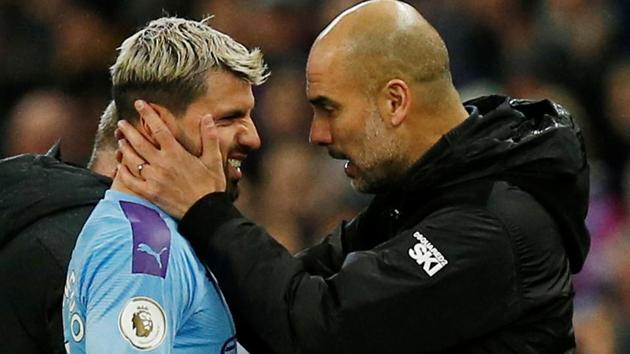 Manchester City manager Pep Guardiola with Sergio Aguero.(REUTERS)