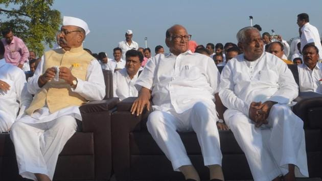NCP President Sharad Pawar, MP Shrinivas Patil (left), and MLA Balasaheb Patil (right) at the samadhi of Maharashtra's first chief minister, the late Yashwantrao Chavan, on the occasion of his 35th death anniversary in Karad on Monday.(Raju Sanadi/HT)