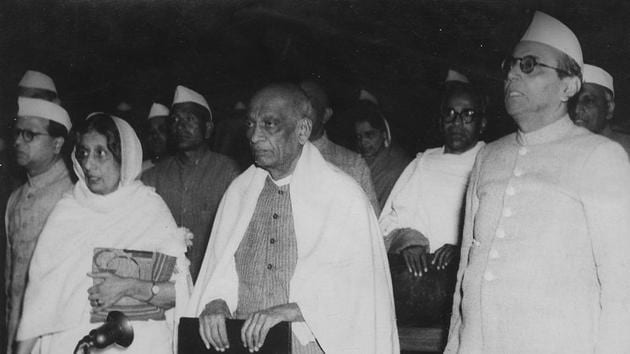 23 November 1949 - Union Health Minister Rajkumari Amrit Kaur, Union Home Minister Sardar Vallabhbhai Patel, BG Kher, First Chief Minister of Bombay state comprising modern Maharashtra and Gujarat states and others Members of the Constituent Assembly stand as the National Anthem is played After India's constitution was adopted by President DR Rajendra Prasad - HT Archive