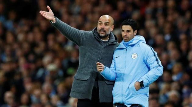 Manchester City manager Pep Guardiola with assistant coach Mikel Arteta.(Action Images via Reuters)
