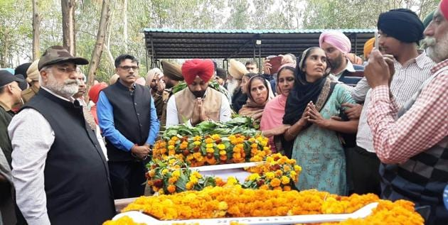 Locals paying tributes to soldier Manpreet Singh of the 18th Sikh Regiment at Longowal village in Sangrur on Wednesday.(HT PHOTO)