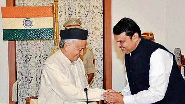Governor BS Koshyari with Devendra Fadnavis during the oath-taking ceremony in Mumbai on Saturday.(PTI File)