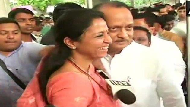 Supriya Sule greets Ajit Pawar at the entrance of the Maharashtra assembly.(Photo: ANI)