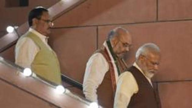 The decisions to give up the claim to form the government in Maharashtra and for Devendra Fadnavis to resign from the post of chief minister were taken at a meeting between Prime Minister Narendra Modi, union home minister Amit Shah and the working president of the Bharatiya Janata Party (BJP), JP Nadda(Burhaan Kinu/HT PHOTO)