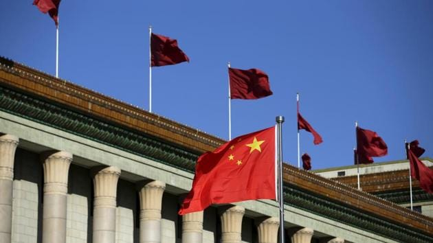Chinese flag waves in front of the Great Hall of the People in Beijing.(Reuters)