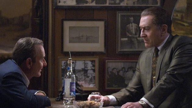 The Irishman movie review: Russell Bufalino (Joe Pesci) and Frank Sheeran (Robert De Niro) talk business.(Niko Tavernise / NETFLIX)