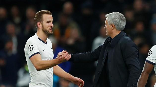 Tottenham Hotspur's Harry Kane celebrates with manager Jose Mourinho(REUTERS)