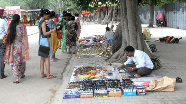 Vendors at Rock Garden have been refusing to accept relocation notices, saying it will hit their livelihood.(HT FILE PHOTO)
