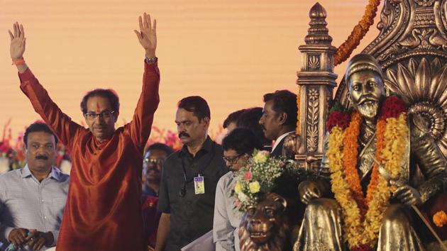 Shiv Sena party leader Uddhav Thackeray waves to supporters as he arrives to takes oath as Maharashtra chief minister in Mumbai.(Photo: AP)