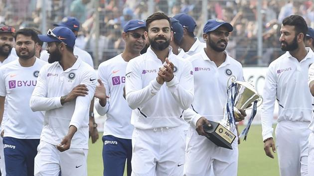 Kolkata: Indian Skipper Virat Kohli with his teammates takes a victory lap after they won the 1st pink ball Test(PTI)