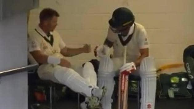 David Warner plays rock-paper-scissors with Joe Burns(Cricket.com.au/ Twitter)