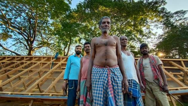 Members led by Dulan Sutradhar are engaged in making Tripura's longest boat.(HT Photo)