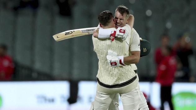 Australia's Marnus Labuschagne celebrates his century with David Warner.(AP)