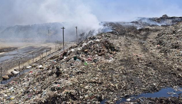 Over 24 lakh metric tonnes of garbage has accumulated at the main dump site on the Tejpur Road in Ludhiana and fire incidents are common at the site.(Gurpreet Singh/Hindustan Times)