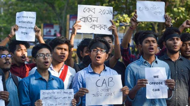 Students hold placards as they protest against the Citizenship (Amendment) Bill, in Guwahati.(PTI)