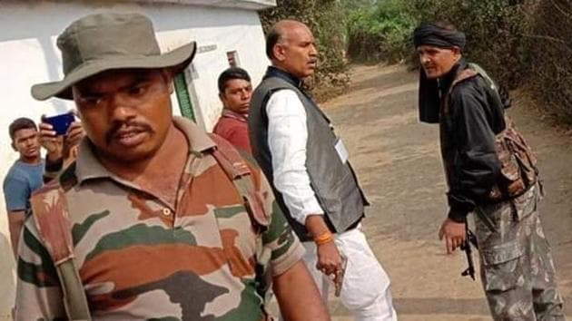 Congress candidate KN Tripathi (middle) of Jharkahnd's Daltonganj assembly constituency flanked by bodyguards.(HT Photo)