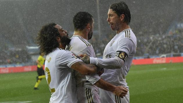 Real Madrid's Dani Carvajal, center, celebrates with teammates Sergio Ramos, right, and Marcelo.(AP)