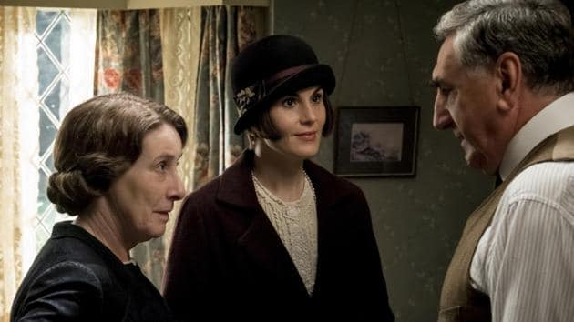 Phyllis Logan as Mrs. Hughes, Michelle Dockery as Lady Mary Talbot and Jim Carter as Mr. Carson in the film Downton Abbey.(AP)